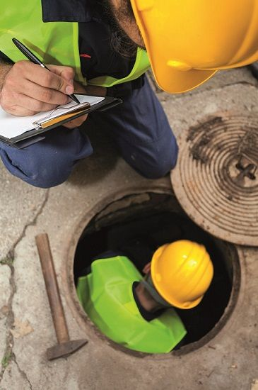 City workers completing a survey